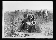Islanders digging trench graves,Kilchoman, Isle of Islay, Scotla