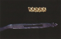 A fragment of a gold finger ring (top) and the decorated end of